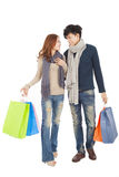Happy couple doing shopping isolated on white Royalty Free Stock Photos