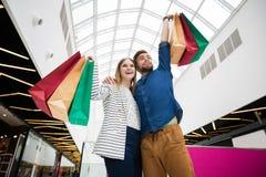Happy couple doing shopping stock photos