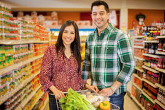 Happy couple doing some shopping Royalty Free Stock Images