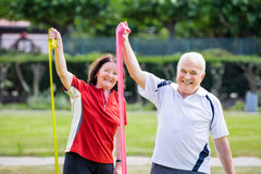 Happy Couple Doing Work Out. Happy Senior Couple Doing Work Out In Park Royalty Free Stock Images