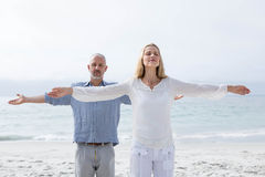 Happy couple doing yoga together Royalty Free Stock Photos
