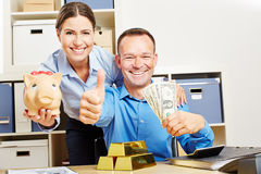 Happy couple with Dollar money and gold Royalty Free Stock Photos