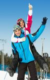 Happy couple of downhill skiers have fun Stock Photos