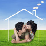 Happy couple with a dream house Royalty Free Stock Photography