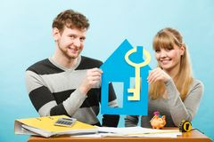 Happy couple dreaming about house. Royalty Free Stock Images