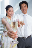 Happy couple dressed up for a date having champagne Royalty Free Stock Photo