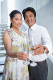 Happy couple dressed up for a date having champagne Stock Photos