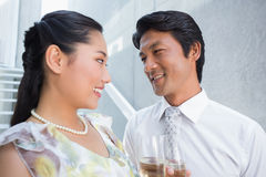 Happy couple dressed up for a date having champagne Royalty Free Stock Photography