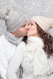 Happy couple dressed in warm clothes in winter royalty free stock photo