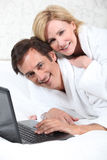 Happy couple in dressing gowns Stock Images
