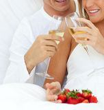 Happy couple drinking champagne Stock Image