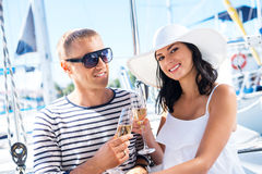 Happy couple drinking champagne on a boat Royalty Free Stock Photos
