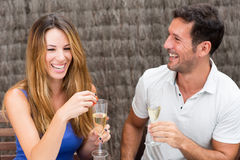 Happy couple drinking champagne. Man and women in love having fun Stock Image