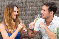 Happy couple drinking champagne. Man and women in love having fun Stock Photos