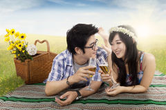 Happy couple drinking champagne on picnic Stock Photo