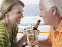 Happy Couple Drinking Champagne On Yacht Royalty Free Stock Image