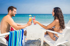 Happy couple drinking a cocktail together. On a sunny day stock images