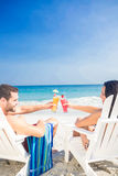 Happy couple drinking a cocktail together. On a sunny day royalty free stock photos
