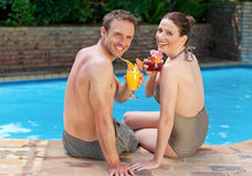 Happy couple drinking cocktails Stock Photography