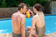 Happy couple drinking cocktails Royalty Free Stock Image