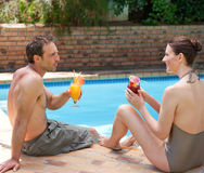 Happy couple drinking cocktails Stock Image