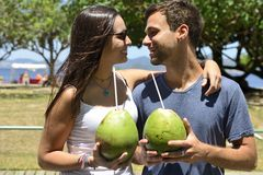 Happy couple drinking coconut water Royalty Free Stock Photo
