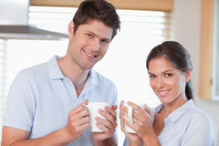 Happy couple drinking coffee Royalty Free Stock Photo
