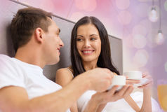 Happy couple drinking coffee in bed Royalty Free Stock Photography