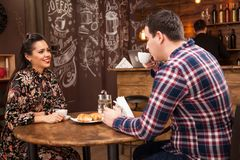 Happy couple drinking coffee in vintage coffee shop royalty free stock photos