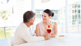 Happy couple drinking a glass Stock Photo