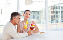 Happy couple drinking a glass Stock Photos