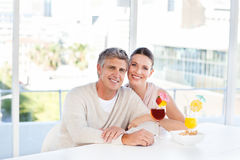 Happy couple drinking a glass Royalty Free Stock Photos