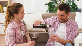 Happy couple drinking red wine at home stock video footage