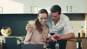 Happy couple drinking red wine at luxury house. Relaxed family clang glasses. stock video footage
