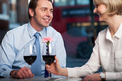 Happy couple drinking red wine at a restaurant Royalty Free Stock Photo