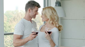 Happy Couple Drinking Red Wine To Celebrate stock video