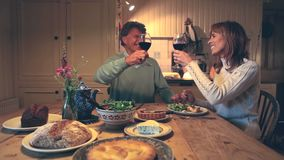 Happy couple drinking red wine together. While having romantic dinner stock video