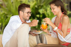 Happy couple drinking refreshment. On summer day Stock Image