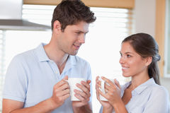Happy couple drinking tea Stock Images