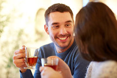 Happy couple drinking tea at cafe Royalty Free Stock Image