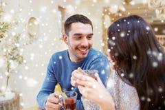 Happy couple drinking tea at cafe Stock Photo