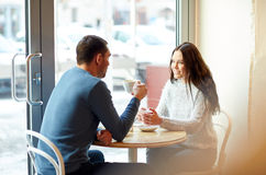 Happy couple drinking tea and coffee at cafe Stock Photography