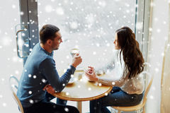 Happy couple drinking tea and coffee at cafe Royalty Free Stock Image