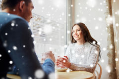 Happy couple drinking tea and coffee at cafe Royalty Free Stock Images