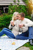 Happy couple drinking tea in a fall park Stock Photography
