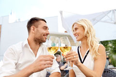 Happy couple drinking wine at open-air restaurant Royalty Free Stock Photography