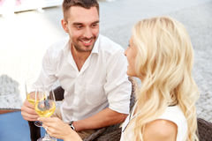 Happy couple drinking wine at open-air restaurant Royalty Free Stock Image