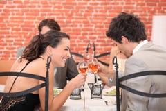Happy couple drinking wine stock photo