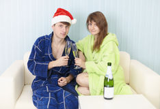 Happy couple drinks sparkling wine Stock Image