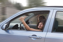 Happy couple driving Stock Images